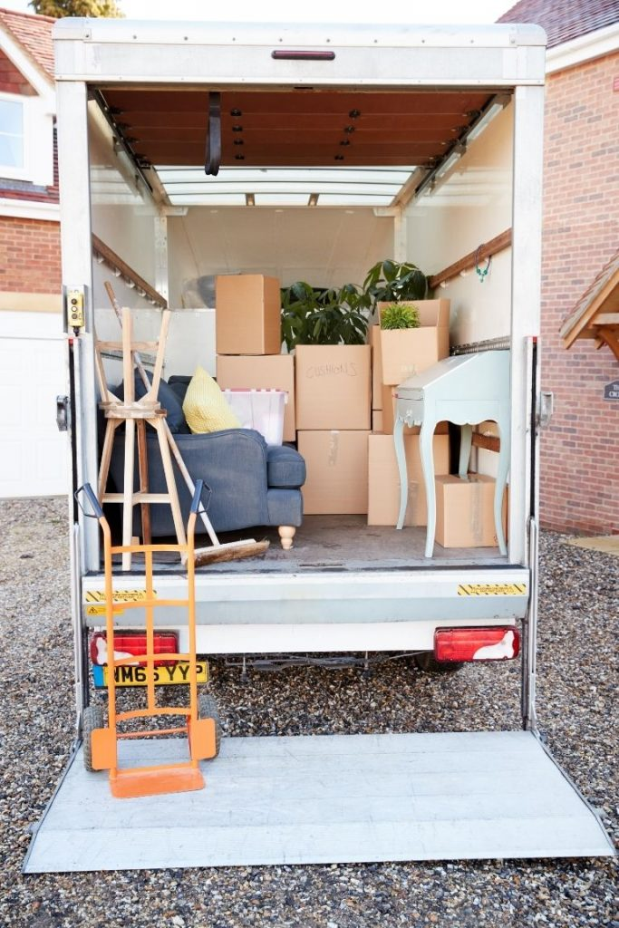 Rear view of a moving truck full of boxes and furniture