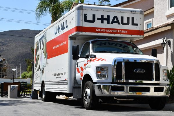 uhaul truck with furniture behind it